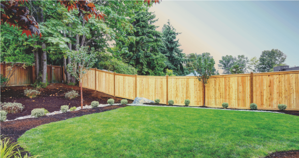 backyard with beautiful natural stained wooden fence and nicely landscape yard